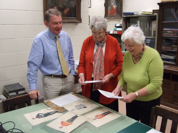 Volunteers and the Curator discussing drawings from  the collection