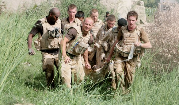 Soldiers from the Worcester and Sherwood Forest regiment lift Davey Graham 21 from Nottingham to be medivaced out off the Green zone in Hellmand provence , Southern Afghanistan after being injured by a gun shot wound in an Ambush by the Taliban